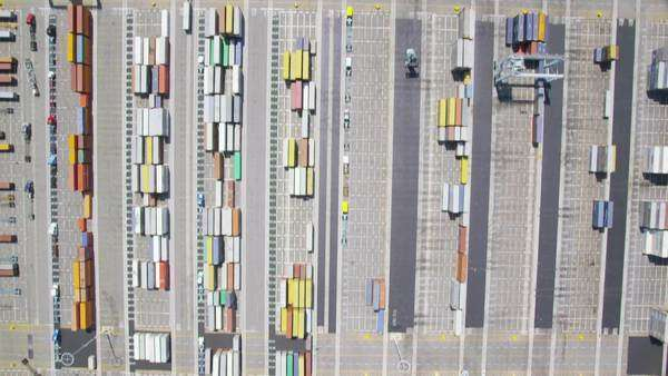 Aerial view of Los Angeles shipping port docks.  Cargo ships loaded with containers and oil. Helicopter shot circling boats and cranes. Royalty-free stock video