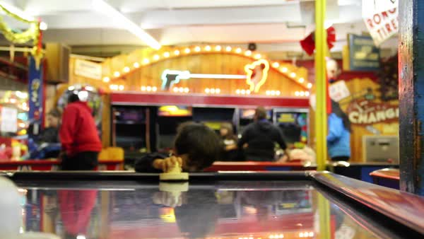 Boy playing air hockey in old-school arcade Royalty-free stock video