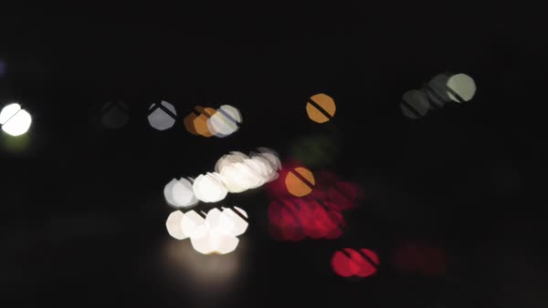 Cars on freeway with head & tail lights going in and out of focus, revealing rad bokeh effect. Royalty-free stock video