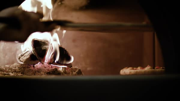 Slow motion of a person putting a pizza into a brick oven Royalty-free stock video