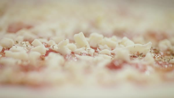 Extreme close-up of a pizza being seasoned Royalty-free stock video