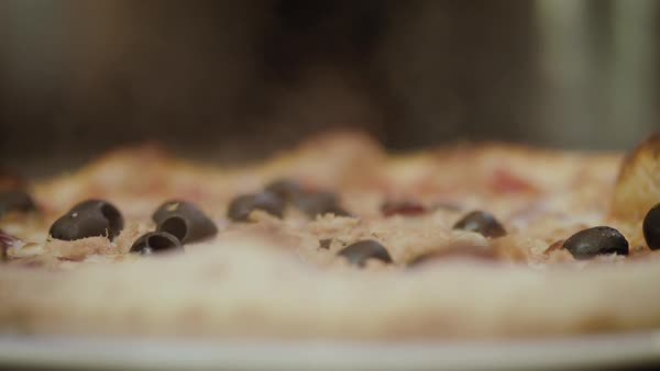 Hand-held shot of a freshly baked pizza being put down Royalty-free stock video