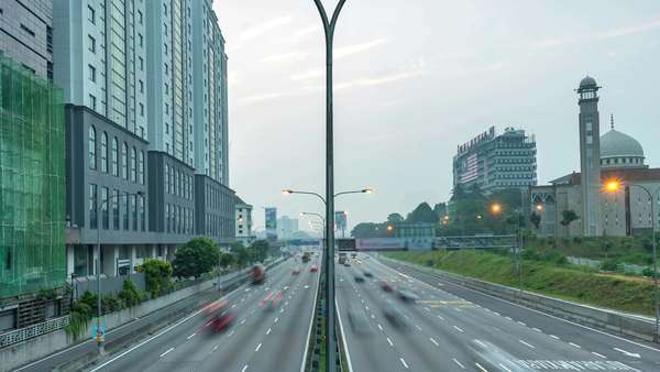 Footage of traffic timelapse at Kuala Lumpur during sunrise. Royalty-free stock video