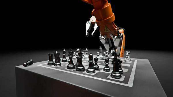 Two assembling robotic arm playing chess Royalty-free stock video