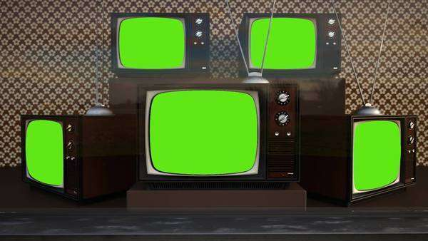 Exhibition Of Old Retro Color Tv Sets With Antenna Green