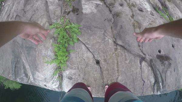 Point of view shot of a man jumping off a cliff Royalty-free stock video
