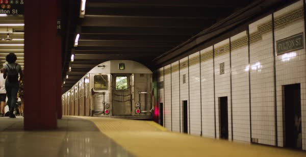 Slow motion of a subway train leaving the station Royalty-free stock video