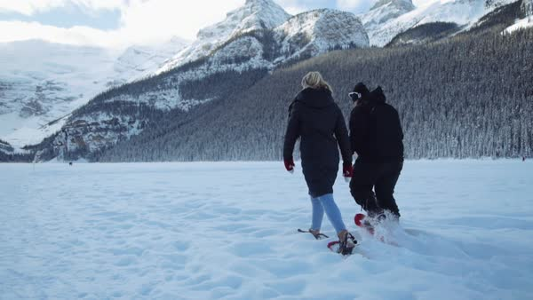 Wide-angle shot of people walking in snowshoes in winter Royalty-free stock video