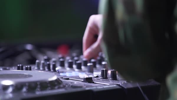 Hand-held shot of a disc jockey mixing music Royalty-free stock video