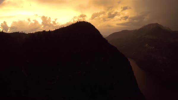 Pan left medium shot of mountains at sunset Royalty-free stock video