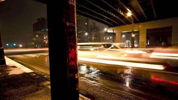 Motion timelapse of cars going under a bridge during a cold and wet evening Royalty-free stock video