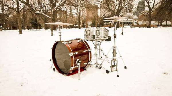 Motion timelapse of a drum set in a snow filled park during a cold and snowy day Royalty-free stock video
