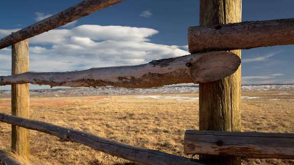 Timelapse of cloud movement and the changing light shot behind a wooden fence Royalty-free stock video