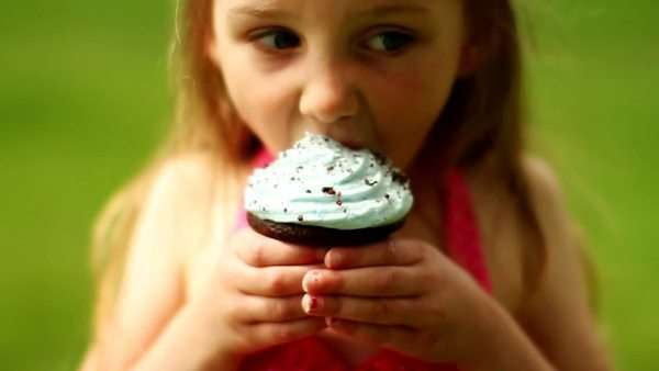 Little girl eating cupcake Royalty-free stock video
