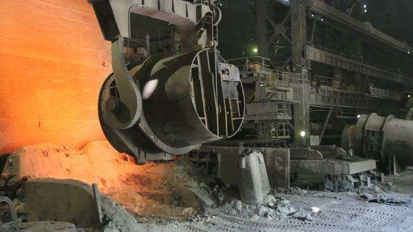 Molten steel being poured from a vat at a foundry. Royalty-free stock video