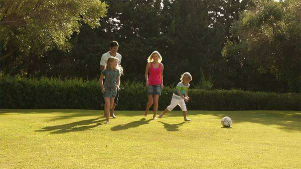 Slow motion shot of family playing soccer. Royalty-free stock video