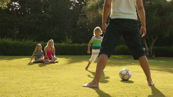 Family playing soccer in garden. Royalty-free stock video