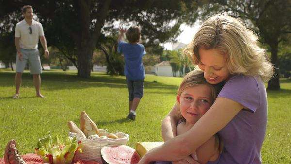 Mother and daughter hugging at family picnic. Royalty-free stock video