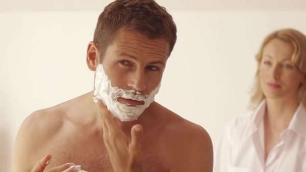 Woman watching man shaving. Royalty-free stock video