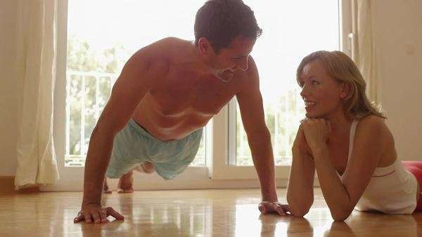 Woman watching man do push-ups. Royalty-free stock video