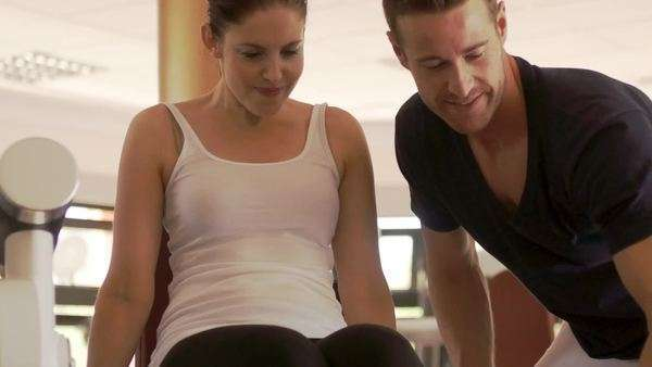Dolly shot of couple exercising at gym. Royalty-free stock video