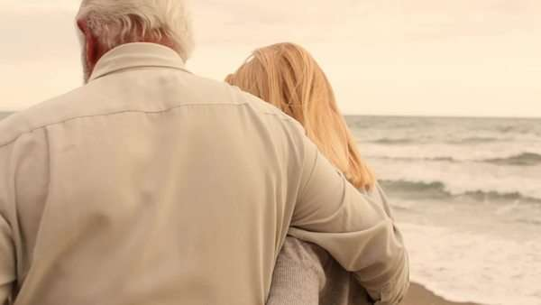 Mature couple on beach walking Royalty-free stock video