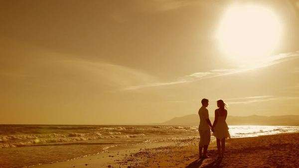 young couple walking on beach in sunset Royalty-free stock video
