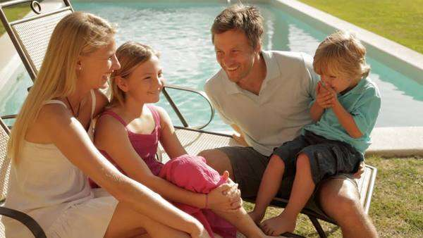 family group sitting by pool Royalty-free stock video