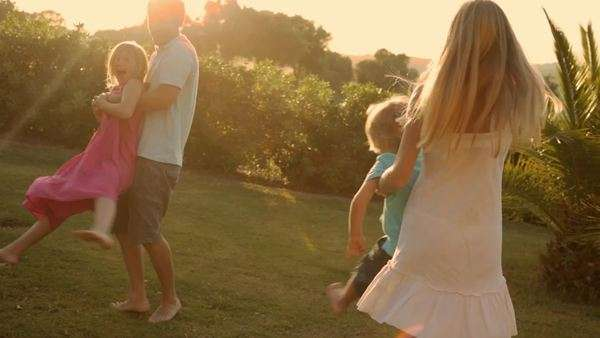 family twirling in sunset Royalty-free stock video