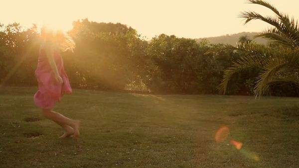 young girl doing cartwheel in sunset Royalty-free stock video