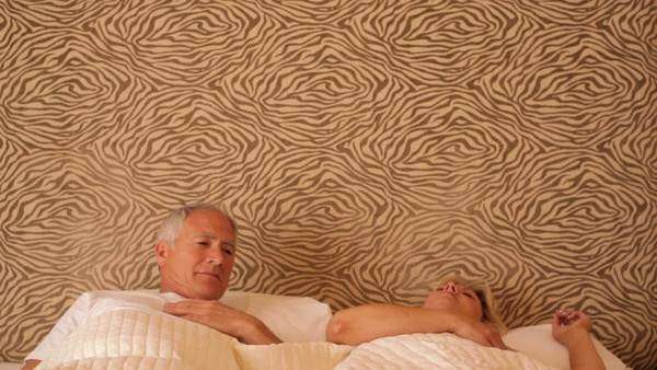 senior couple waking and stretching in bed Royalty-free stock video