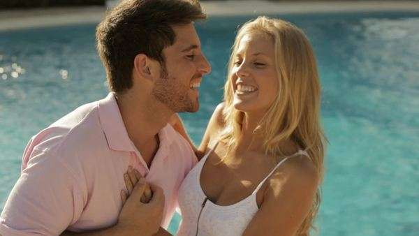 young couple sitting by pool Royalty-free stock video