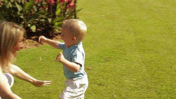 Little boy running into mother's arms in park. Royalty-free stock video