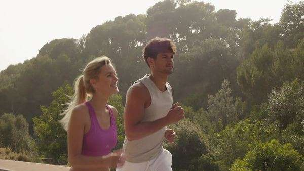 Couple jogging on road in countryside. Royalty-free stock video