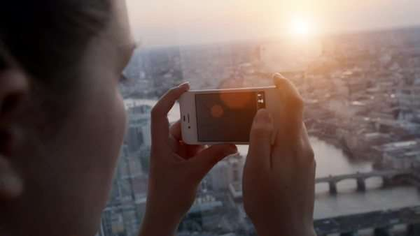 Tourist taking photograph of sunset in london skyline  view from The Shard Royalty-free stock video