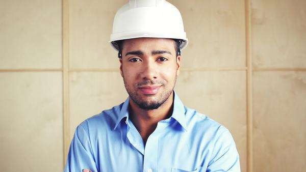 Happy foreman with arms folded at building site inspection Royalty-free stock video