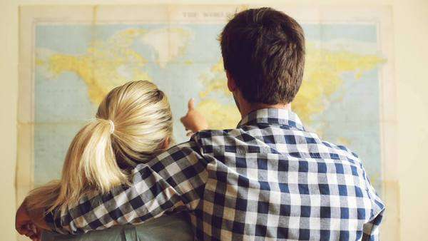 Young tourist couple looking at world map will travel Royalty-free stock video