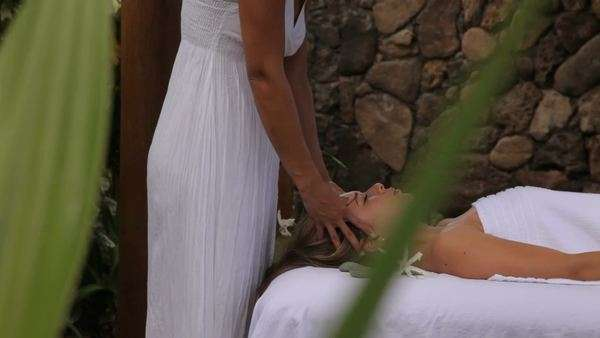 Woman gets massage at tropical resort spa Royalty-free stock video