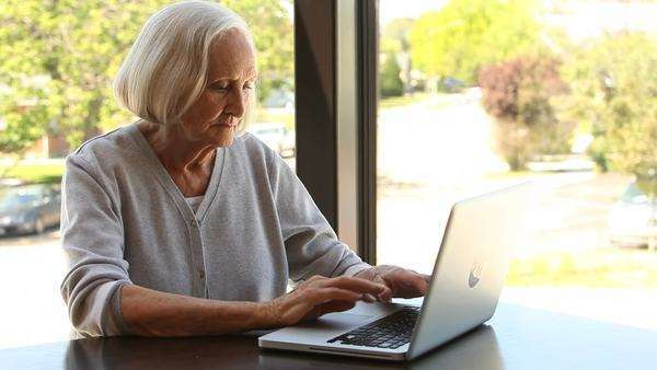 Portrait of elderly woman with laptop Royalty-free stock video