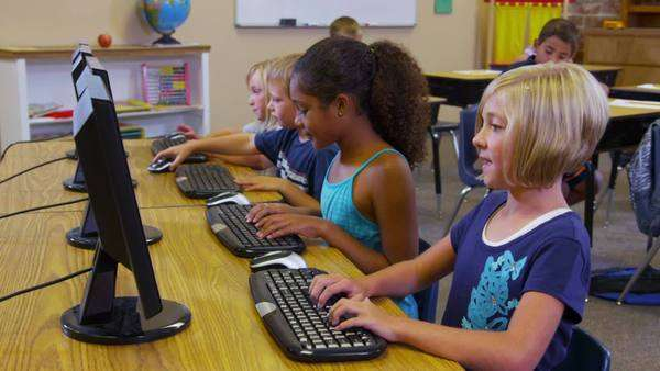 Elementary school students work with computers Royalty-free stock video