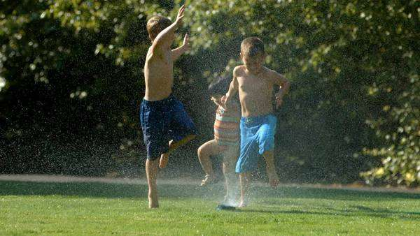 Kids playing in sprinkler, slow motion Royalty-free stock video