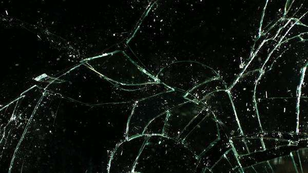 Glass shatters and falls, slow motion Royalty-free stock video