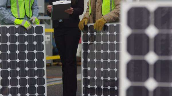 Industry workers plan solar panel installation Royalty-free stock video