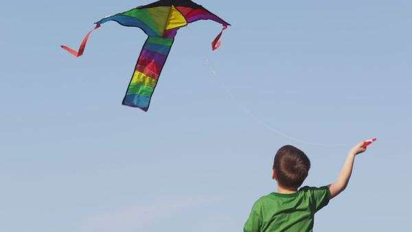 Young boy flying kite, slow motion Royalty-free stock video