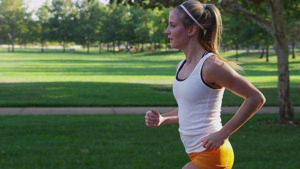 Young woman jogging in park Royalty-free stock video