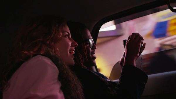 Young couple riding in taxi cab, New York City Royalty-free stock video