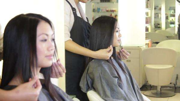 MS, Hairdresser showing to customer hair cut Royalty-free stock video