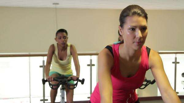 Group working out on bicycles in a gym Royalty-free stock video