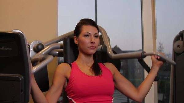 Female working out in gym on exercise machine Royalty-free stock video