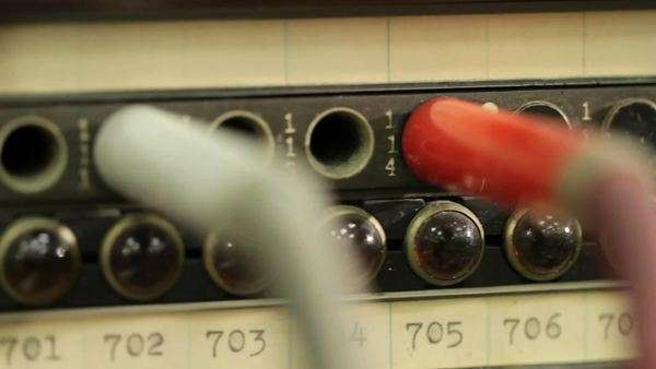 Macro shot as camera moves down across the cables and sockets on an old telephone switchboard Royalty-free stock video
